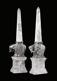 A Fine Pair of Continental Rock Crystal Obelisks on silvered metal elephant form bases from the late 20th century - Dim: 22 in. high.