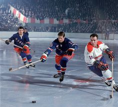 "Montreal center Henri ""The Pocket Rocket"" Richard skates past Jean Ratelle (No. 19) and Rod Gilbert during a 1967 game between the Rangers and Canadiens."