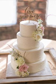 We love this cake with romantic wedding cake topper ❤. For more inspiration see http://www.weddingforward.com/wedding-cake-topper-ideas-inspiration/ #weddingcaketoppers  #weddingcake