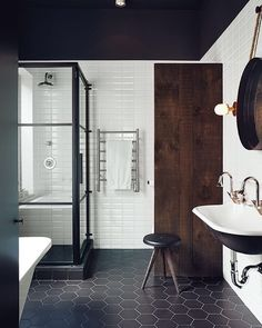 """In the master bath a dowdy tub was replaced with a standing shower designed by Di Ioia and Bédard and manufactured by Linea P International. The wall and floor tiles are by Ceragres and the sink tub and towel rack are by Aqua Mobilier de Bain. #bathroom  Photo by Michael Graydon  Nikole Herriott @dwellmagazine..."