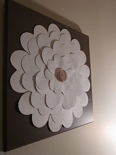 Pretty Flower Wall Art » paper hearts layered to make a flower with a button in the middle