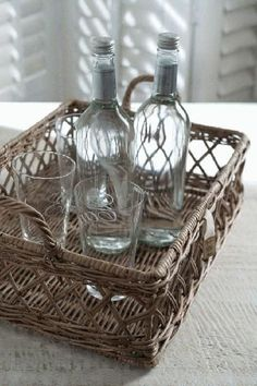 """10 Ways to """"Hotel-ify"""" Your Guest Bath by The Everyday Home - Bottled Water and Glasses"""