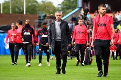Manager of Manchester United Jose Mourinho and his team walk on the pitch before the Premier League match between Burnley FC and Manchester United at. Burnley Fc, Premier League Matches, Walk On, Manchester United, Pitch, Management, The Unit, Sports, Hs Sports