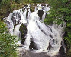 Swallow Falls is the highest continuous waterfall in Wales. The falls are set on the River Llugwy two miles west of Betws-y-Coed along the to Capel Curig, in the beautiful Gwydir Forest. Wales Holiday, Nature Green, Snowdonia National Park, Time In The World, England And Scotland, Forest Park, Beautiful Places To Visit, Amazing Places, Places Of Interest
