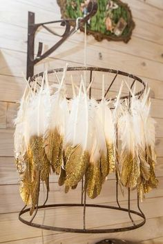 Amie created this fixture from an old lampshade frame and bleached turkey feathers dipped in gold glitter, and then attached them with fishing line http://www.gactv.com/gac/shows_hjkgp/article/0,3561,GAC_45849_6072636_11,00.html?soc=pinterest    not just for weddings? :)