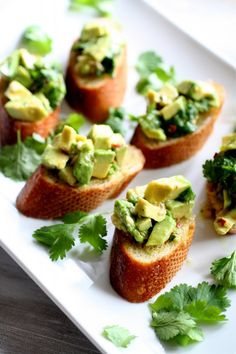 Avocado Chimichurri Bruschetta. Creamy, spicy, crispy, bite-sized, all the best things!