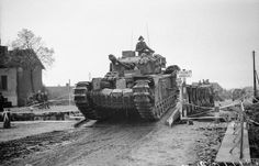 Churchill tanks crossing a Bailey bridge over the Antwerp-Turnhout canal at Rijckevorsel during the attack north of Antwerp, 22 October 1944. IWM