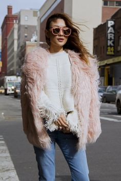 blush pink fuzzy coat with cream sweater and blush sunglasses