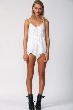 Spaghetti strap playsuit. White lace detailing. V neckline. Inner shorts lining. Polyester.