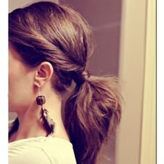 Simply part your hair down the middle, twist both chunks down to the nape of your neck and secure with a ponytail wrapping your hair about the tie. Classic and feminine!