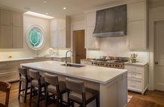 The window makes this clean white kitchen glamorous.