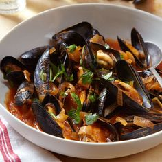 Mussels Steamed in Tomato Broth with Goat Cheese | Mussel and tomato juice and celery seeds make a delicious broth to accompany steamed mussels. Look for farmed mussels; they're clean, so you'll only have to scrub them briefly.