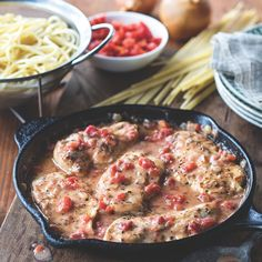 Just like it's done in a restaurant – chicken cutlets seasoned with Italian herbs in a chunky tomato sauce served over pasta.
