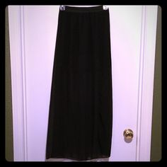 """Gorgeous black shear maxi skirt Excellent condition, Charlotte Russe maxi skirt. Has a short mini skirt with beautiful sheer fabric that goes to your ankles. Mini skirt measures 15"""" from top of waist to bottom hem. Long sheer fabric measures from top of waist to hem  38 1/2"""" smoke free home. All reasonable offers accepted. Thanks for taking a peek in my closet  Charlotte Russe Skirts Maxi"""