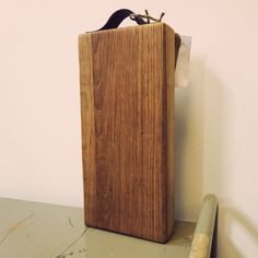 A beautiful cutting board or serving tray from Food Safe oak, with a leather handle.  Made from 100% recycled wood.