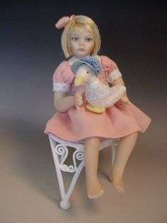 dollhouse girl with her little Jemima Puddle-Duck