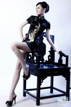 Now that's the way to wear a qipao if you've got the legs for it!