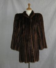 Elegant 1940's Sable dyed Marmot fur swing coat. Sleeves unzip to convert to a cape!