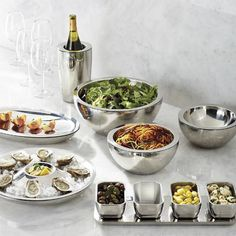 Our Super Chill Insulated Servers are prized for their polished presence and superb temperature regulating abilities at your buffet table. Designed to keep foods perfectly chilled for several hours without ice or condensation, the gleaming, seamless serveware is ideal for summer socials staged outdoors or indoors.Party Set includes: Super Chill Appetizer Tray, 14 Hot/Cold Tray and Super Chill Wine ChillerDouble-walled 18/8 stainless steel provides maximum cold retentionGel-based inn...