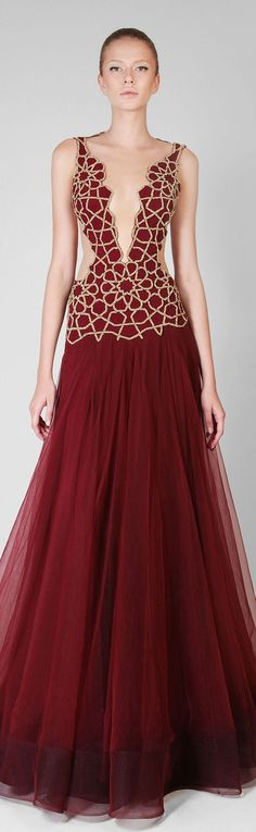 Rami Kadi (I would also add, if the detail is cord, cord strands down the length of the skirt with glistening beads pseudo-randomly distributed along them)