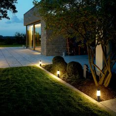 Luminaires with earth spike with cylinder diffuser with cap. In paths, flowerbeds and on terraces these unshielded luminaires create a pleasant lighting effect. The earth spike mounting allows for flexible and portable installation. Outdoor Garden Lighting, Led Outdoor Wall Lights, Garden Lighting Ideas, Modern Landscaping, Backyard Landscaping, Modern Landscape Lighting, Portable Led Lights, Backyard Retreat, Private Garden