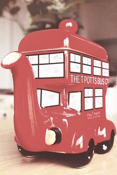 The T Potts Bus Co. novelty teapot in shape of London's red Routemaster double decker bus w/ name lettered on the side, ceramic, likely UK ... a great souvenir