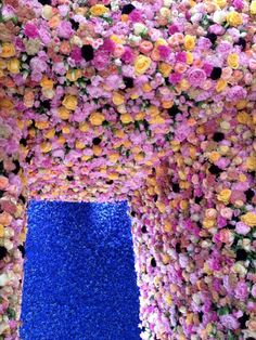 The decor for Raf Simons' Dior debut collection-yes, those are real flowers