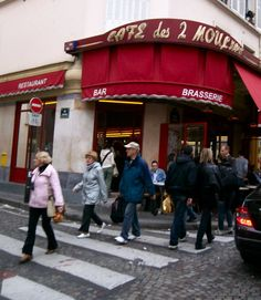 Montmartre Paris Les Deux Moulins Parisian Cafe where the film Amelie was set! If you love the film Amelie, do not miss this restaurant, with subtle homages to the movie, it will be a memorable experience, look for the gnome in the back as well as be sure to try Amelie's Creme Brulee