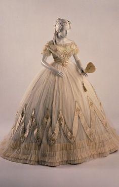 1860 - 1863 dress | silk (net, taffeta, lace, ribbon); glass (simulated pearls)