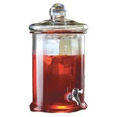 """Glass beverage dispenser.     Product: Beverage dispenserConstruction Material: Glass and metalColor: ClearFeatures: 1.3 Gallon capacityDimensions: 13.5"""" H x 9.5"""" DiameterCleaning and Care: Hand wash"""