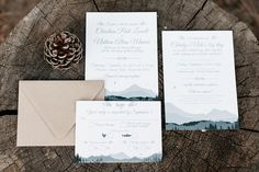Nature-inspired wedding stationery idea - white cards with mountain illustrations, modern calligraphy + blue accents {Catie Coyle Photography}