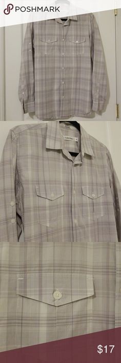 "Men's Calvin Klein Long Sleeve Shirt Size S Can roll up sleeves and secure with buttons. In excellent condition but missing the top button. Smoke and pet free home. 30"" long. 21"" arm pit to arm pit. 19.5"" arm pit to cuff. Calvin Klein Shirts Casual Button Down Shirts"