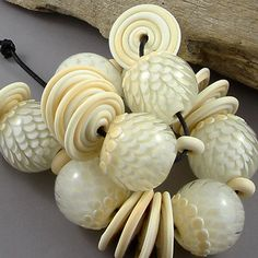 Magma Beads Swan Handmade Lampwork Beads | eBay No longer available but gorgeous just the same.