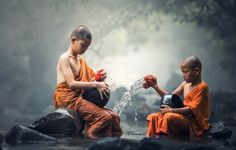 Asian Novice monks - Asian Novice monks cleaning alms bowl in creeks