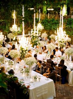 LONG TABLES AL FRESCO WITH CHANDELIERS CREATES A SUMPTUOUS OUTDOOR DINING EXPERIENCE
