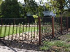 Black Flat Top Aluminium Fencing With Timber Posts By