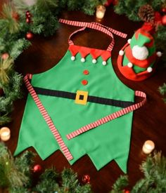 Oh Kam you will hate me one day. This matches my decor this year perfectly! Can't wait to see my little elf in this! Little Elf Apron Christmas Elf Costume, Christmas Aprons, Christmas Table Cloth, Christmas Plates, Christmas Sewing, Kids Christmas, Xmas, Halloween, Christmas 2019