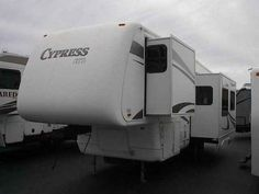 2006 Used Newmar CYPRESS 29KSRE Fifth Wheel in Florida FL.Recreational Vehicle, rv, 2006 Newmar CYPRESS 29KSRE, NEWMAR QUILITY,TRIPLE SLIDE,ONAN GEN,REAR LIVING,FRONT ISLAND QUEEN,WE SOLD THIS COACH NEW JUST TRADED ON TOY HAULER,THIS COACH HAS BEEN SLIGHTY SMOKED INSIDE,BUT VERY CLEAN,...PLEASE NOTE ALL UNITS COME WITH PREDELIVERY INSPECTION BY CERTIFIED RV TECH,BATTERY AND BOX,PROPANE,STARTER KIT WITH CAMPING ESSENTIALS,FULL CLEANING FROM DETAIL CREW,FULL DEMO FROM THE SAME RV TECH THAT DID…