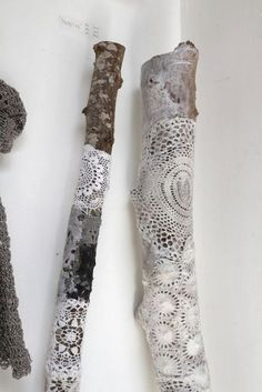 Mod Podge doilies onto sticks - I'm doing this to make a curtain rod :)