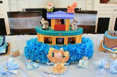 Fisherprize playset turned centerpiece for Noah ark baby shower