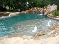 Pool Designs With Rock Slides islands rocks slides grottos caves pool builders Dolce Pools Design Consists Of Elevated Spa Extended Tanning Ledge With Water Bubble Jets