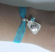 Beach glass bracelet with Sand dollar. Sea by SeaGlassJewelryEtsy