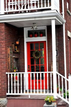 I LOVE this red door! I love that whole entryway... the designer too! :)
