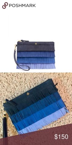 Tory Burch Blue Toned Fringe Pouch Stunning blue toned wristlet by Tory Burch. Approx. 6x8 inches. Tags removed but never used. Perfect condition.   • NEW • Fast response  • Brand is Tory Burch • Brand new but tag removed Tory Burch Bags Clutches & Wristlets