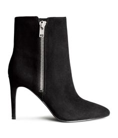 Ankle boots in imitation suede with pointed toes, visible side zip, and rubber soles. Heel height 4 in. High Heel Boots, Heeled Boots, High Heels, Black Booties, Ankle Booties, Black Shoes, Toe, Zipper