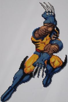 If you're going to make a bead sprite of Wolverine,make it show him in action. Wolverine from X-Men: COTA/various Marvel games. Done in Perler. Perler Patterns, Bead Patterns, Geek Crafts, Diy And Crafts, Geek Perler, Lego Mosaic, Graph Paper Art, Marvel Games, Marvel Avengers