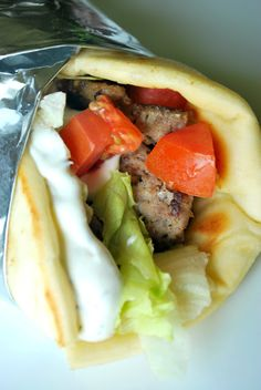Gyros ~ Uses beef and pork or lamb. I add finely chopped cucumber to the sauce.