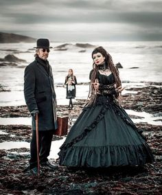 Gothic Victorian Couple/Family - For costume tutorials, clothing guide, fashion inspiration photo gallery, calendar of Steampunk events, & more, visit SteampunkFashionGuide.com