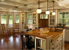 Love the different counter heights with the butcher block and the extra outlet to plug in small appliances.