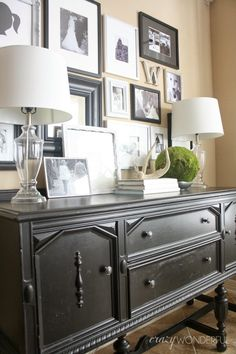 Great gallery wall - mix old and new photos. Add non photo art. Layer frames on credenza.